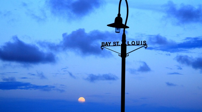 The moon rises in Bay St. Louis Mississippi.