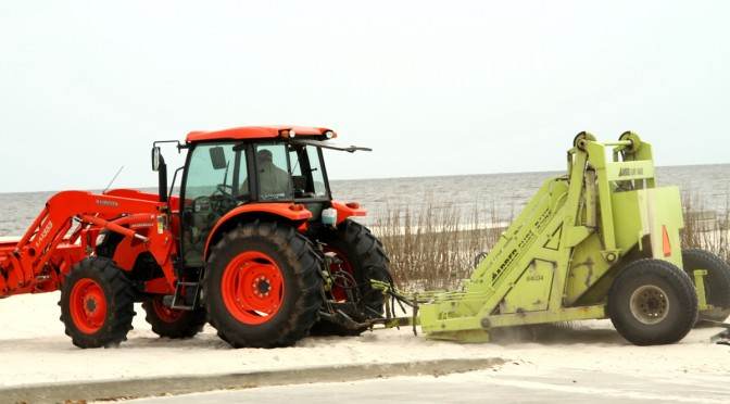 The Tractors Are Working On The White Sandy Mississippi Beaches